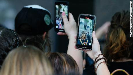 People use their cell phones to record a speaker during a protest against police brutality on June 6, in Atlanta.