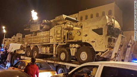 Forces loyal to Libya's UN-recognized government parade a Russian-made Pantsir air defense system truck in Tripoli on May 20, after its capture from forces loyal to Khalifa Haftar at al Watiya airbase.