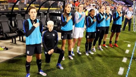 Megan Rapinoe of the US Women's National Team kneels during the playing of the US National Anthem before a match against Thailand on September 15, 2016, at MAPFRE Stadium in Columbus, Ohio.