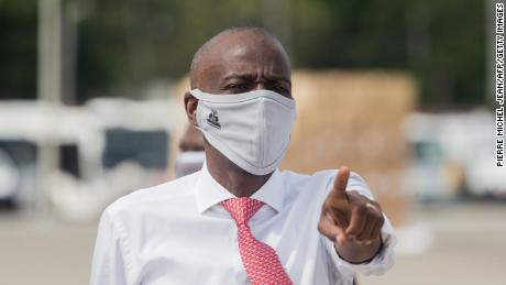 Haitian President Jovenel Moise instructs staff members on the tarmac of  Toussaint Louverture International Airport in Port-au-Prince on May 7, 2020, as coronavirus aid from China arrives in a cargo plane.
