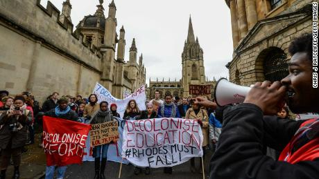 Students demonstrate outside Oxford University's All Souls College where a staute of Christopher Codrington is based which they are campaigning to be removed from the building on March 9, 2016 in Oxford, England. The demonstrators are calling for statues of colonial era figures including Cecil Rhodes and Queen Victoria to removed from university campuses. Cecil Rhodes was a british businessman and politician in South Africa, who served as Prime Minister of the Cape Colony from 1890 to 1896.