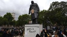 Protesters gather in Parliament Square, London, around the statue of Winston Churchill after it was defaced during a Black Lives Matter protest in June 2020.
