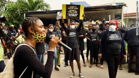 Demonstrators and activists from rights organizations protest in front of the Nigerian Police Force headquarters in Lagos.