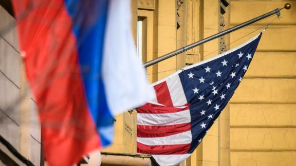 A Russian flag flies next to the US embassy building in Moscow on October 22, 2018. - US national security advisor John Bolton is in Moscow holding meetings with senior Russian officials following Washington's weekend announcement of withdrawal from the Cold War-era Intermediate-Range Nuclear Forces Treaty, known as the INF. (Photo by Mladen ANTONOV / AFP)        (Photo credit should read MLADEN ANTONOV/AFP via Getty Images)