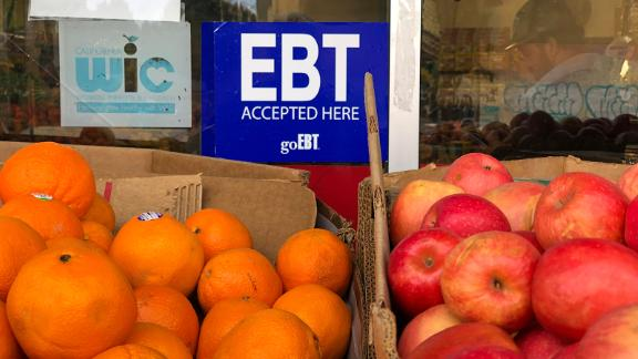 OAKLAND, CALIFORNIA - DECEMBER 04: A sign noting the acceptance of electronic benefit transfer (EBT) cards that are used by state welfare departments to issue benefits is displayed at a grocery store on December 04, 2019 in Oakland, California. Nearly 700,000 people are set to lose their food stamp benefits after the Trump administration announced plans to reform the Supplemental Nutrition Assistance Program, or SNAP.  (Photo by Justin Sullivan/Getty Images)