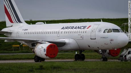 This picture shows an Air France plane parked on the tarmac at Paris' Charles de Gaulle Airport.