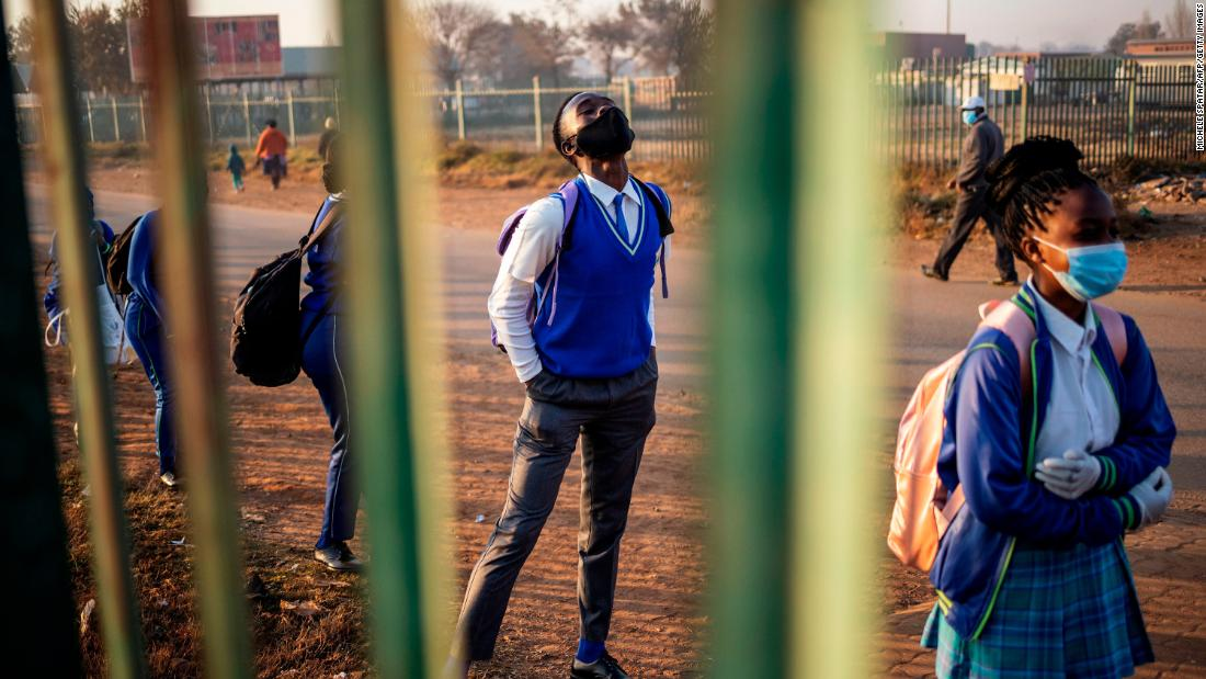 Students at the Winnie Mandela Secondary School wait in line before classes resumed in Tembisa, South Africa, on June 8. Students began returning to classrooms after two and a half months of home-schooling.