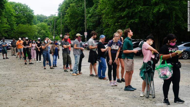 People wait in line to vote in Georgia's Primary Election on June 9, 2020 in Atlanta.