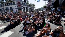 Demonstrators stage a sit-in on Tuesday, June 9, on Sunset Boulevard in Los Angeles during a protest over the death of George Floyd.
