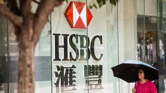 "A pedestrians walks past HSBC signage in the Admiralty district of Hong Kong on July 31, 2017. HSBC said on July 31 pre-tax profit for the first half of 2017 had risen five percent to 10.2 billion USD compared with the same period last year, in what it called an ""excellent"" result following a turbulent 2016. / AFP PHOTO / ISAAC LAWRENCE        (Photo credit should read ISAAC LAWRENCE/AFP via Getty Images)"