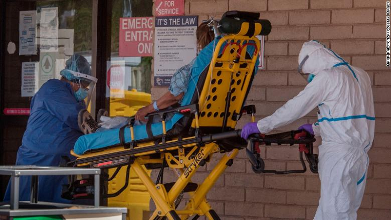 A patient is taken from an ambulance to the emergency room of a hospital in the Navajo Nation town of Tuba City.