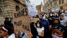 Demonstrators at a Rhodes Must Fall protest outside Oriel College at the University of Oxford on June 9.