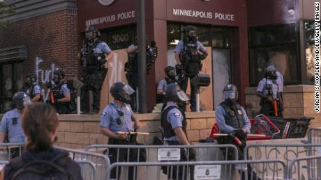 Police stand guard at a Minneapolis Police precinct in Minneapolis on May 27, 2020.