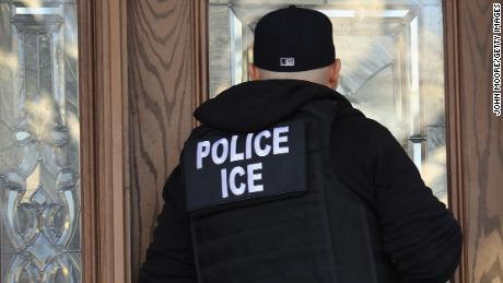 U.S. Immigration and Customs Enforcement officers arrive to a New York home in search of an undocumented immigrant in 2018.