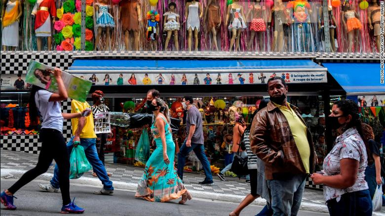 People walk along a street in downtown Sao Paulo, Brazil on Wednesday.