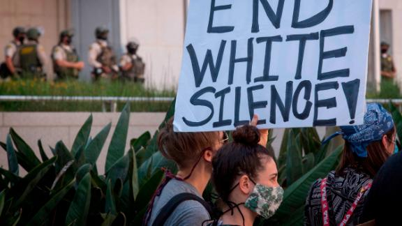 Supporters of Black Lives Matter hold signs during a protest on June 10, 2020, in Los Angeles.
