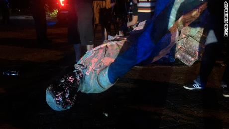 The statue of Confederate President Jefferson Davis is splattered with paint after it was toppled June 10 in Richmond.
