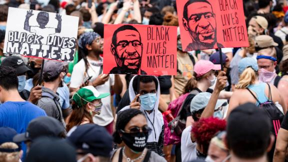 WASHINGTON, DC - JUNE 06: Protesters walk along the recently renamed Black Lives Matter Plaza with signs near the White House during George Floyd protests on June 6, 2020 in Washington, D.C. This is the 12th day of protests since George Floyd died in Minneapolis police custody on May 25. (Photo by Samuel Corum/Getty Images)
