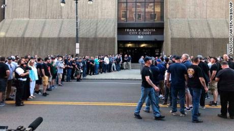 In this photo provided by WKBW, supporters of two suspended Buffalo police officers assemble outside the courthouse in Buffalo, N.Y., Saturday, June 6, 2020. According to prosecutors, both officers were charged with assault Saturday, after a video showed them shoving a 75-year-old protester in a recent demonstration over the death of George Floyd. (Madison Carter/WKBW/AP)