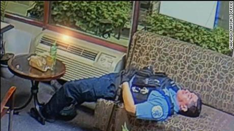 One still image released by the mayor's office shows an officer appearing to sleep on an office couch.