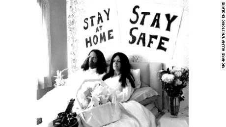 A tongue-in-cheek recreation of John Lennon and Yoko Ono's Bed-Ins for Peace, with the slogans 'Stay at Home' and 'Stay Safe', taken during lockdown in Milton Keynes, England