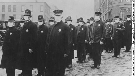 Policemen in Seattle wearing protective gauze face masks during the influenza epidemic of 1918 which claimed millions of lives worldwide