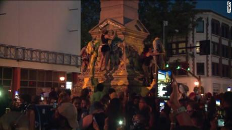 Man injured as protesters partially dismantle Confederate monument in Virginia