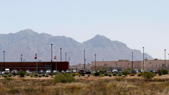 Vehicles are parked outside the La Palma Correctional Center in Eloy, Arizona, May 2010.