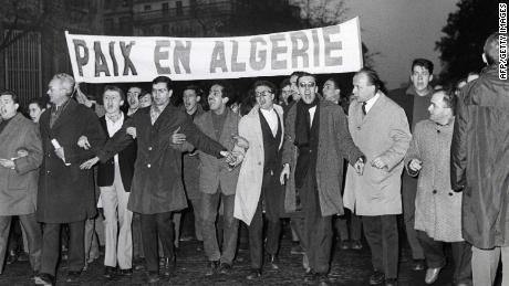Protesters call for Algerian independence and peace in Paris on November 18, 1961.