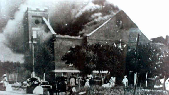FILE - In this 1921 file image provided by the Greenwood Cultural Center via Tulsa World, Mt. Zion Baptist Church burns after being torched by white mobs during the 1921 Tulsa massacre. Black community and political leaders called on President Donald Trump to at least change the Juneteenth date for a rally kicking off his return to public campaigning, saying Thursday, June 11, 2020. From Sen. Kamala Harris of California to Tulsa civic officials, black leaders said it was offensive for Trump to pick that date — June 19 — and that place — Tulsa, an Oklahoma city that in 1921 was the site of a fiery and orchestrated white-on-black killing spree. (c)