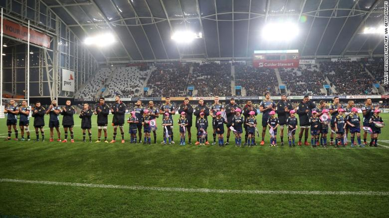 The Otago Highlanders team line up before the start of the game at the Forsyth Barr Stadium in Dunedin, the first since Covid-19 restrictions were largely lifted in New Zealand.