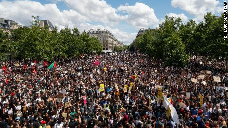 Thousands of people demonstrate against police brutality and racism in Paris on Saturday, before a march organized by supporters of Adama Traore, who died in the custody of French police in 2016.