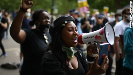 A woman addresses protesters gathered in support of the Black Lives Matter movement in Hyde Park, central London on Saturday.
