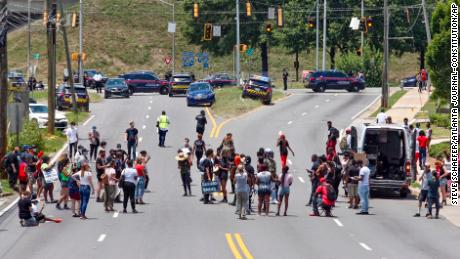 Protestors block University Avenue near the Wendy's restaurant in Atlanta on Saturday, June 13, 2020, where Rayshard Brooks, a 27-year-old black man, was shot and killed by Atlanta police Friday evening during a struggle in the restaurant's parking lot.