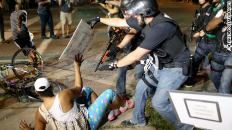 Police officers arrest a demonstrator in Ferguson, Missouri, during protests following the death of Michael Brown in August 2014.