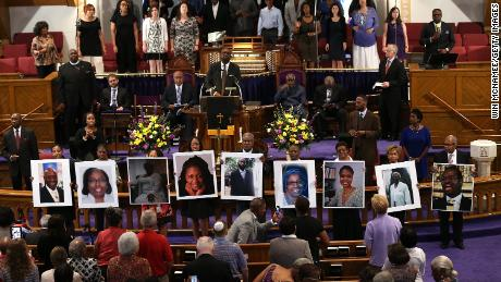 Photos of the nine victims killed at the Emanuel African Methodist Episcopal Church are held up by congregants during a prayer vigil in Washington.