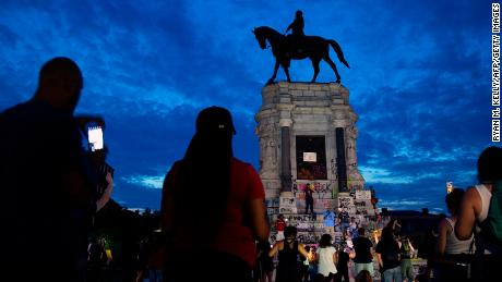 People gather around a Robert E. Lee statue in Richmond, Virginia, this month.