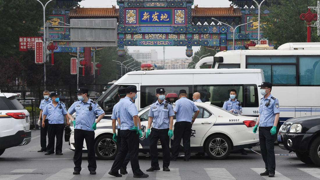 Chinese police guard the entrance to the closed Xinfadi market in Beijing on June 13, 2020. - Eleven residential estates in south Beijing have been locked down due to a fresh cluster of coronavirus cases linked to the Xinfadi meat market, officials said on June 13. (Photo by GREG BAKER / AFP) (Photo by GREG BAKER/AFP via Getty Images)