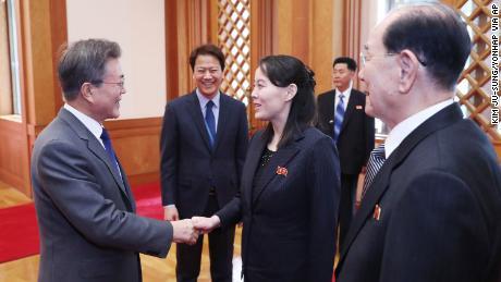 South Korean President Moon Jae-in, left, shakes hands with Kim Yo Jong, North Korea leader Kim Jong Un's sister.