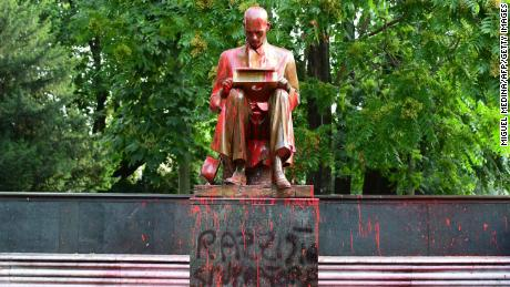 """A view shows a statue of a famous Italian journalist Indro Montanelli on June 14, 2020 in a Milan public square, a day after it was defaced, stained with red paint and tagged with the inscription """"racist, rapist"""". - It is the first statue to be damaged in Italy since the wave of protests around the world triggered by the death of George Floyd in the US. (Photo by MIGUEL MEDINA / AFP) (Photo by MIGUEL MEDINA/AFP via Getty Images)"""