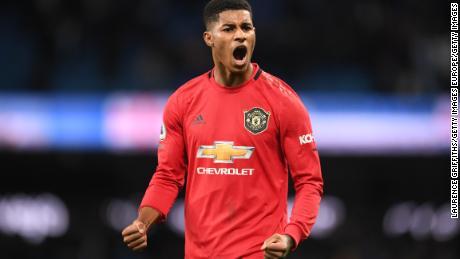 Rashford celebrates following United's victory over Man City last December.