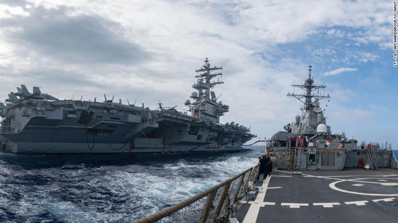 The guided-missile destroyer USS Barry operates with the aircraft carrier USS Ronald Reagan in the Philippine Sea on May 30.