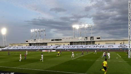"Real Madrid chose to use the empty stands at the Estadio Alfredo di Stefano to display a banner reading ""In our hearts"" paying tribute to coronavirus victims."