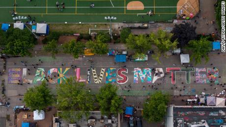 "SEATTLE, WA - JUNE 14: An aerial view of a Black Lives Matter mural on East Pine Street near Cal Anderson Park is seen during ongoing Black Lives Matter events in the so-called  ""CHOP,"" an area that protesters have called both the ""Capitol Hill Occupied Protest"" and the ""Capitol Hill Organized Protest, on June 14, 2020 in Seattle, Washington. Black Lives Matter protesters have continued demonstrating in what was first referred to as the Capitol Hill Autonomous Zone, which encompasses several blocks around the Seattle Police Departments vacated East Precinct. (Photo by David Ryder/Getty Images)"