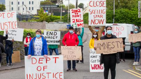Cahersiveen locals and residents of the Skellig Star Direct Provision Centre call for the immediate resignation of Justice Minister Charlie Flanagan on Tuesday, June 9, outside the Legal Aid Board Offices in Cahersivee, Ireland.
