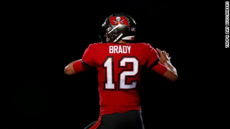 tom brady buccaneers unveil first photos of brady in his new uniform cnn tom brady buccaneers unveil first