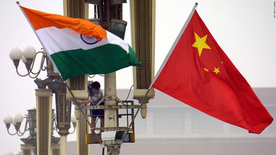 Workers put up the Indian flag (L) alongside the Chinese flag on Tiananmen Square in Beijing, 22 June 2003, ahead of Indian Prime Minister Atal Behari Vajpayee's arrival. Vajpayee's visit is the first to China by an Indian premier in a decade, as the two Asian giants which account for a third of the world's population, have had unsteady relations since a bloody 1962 border war, while fifteen rounds of talks since the 1980s have failed to resolve their boundary disputes.     AFP PHOTO (Photo by - / AFP) (Photo by -/AFP via Getty Images)