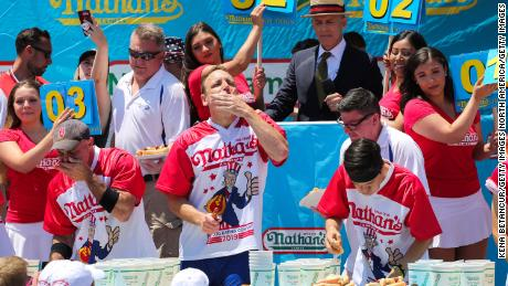 Joey Chestnut eats his way to victory at last year's Nathan's Famous Hot Dog Eating Contest.