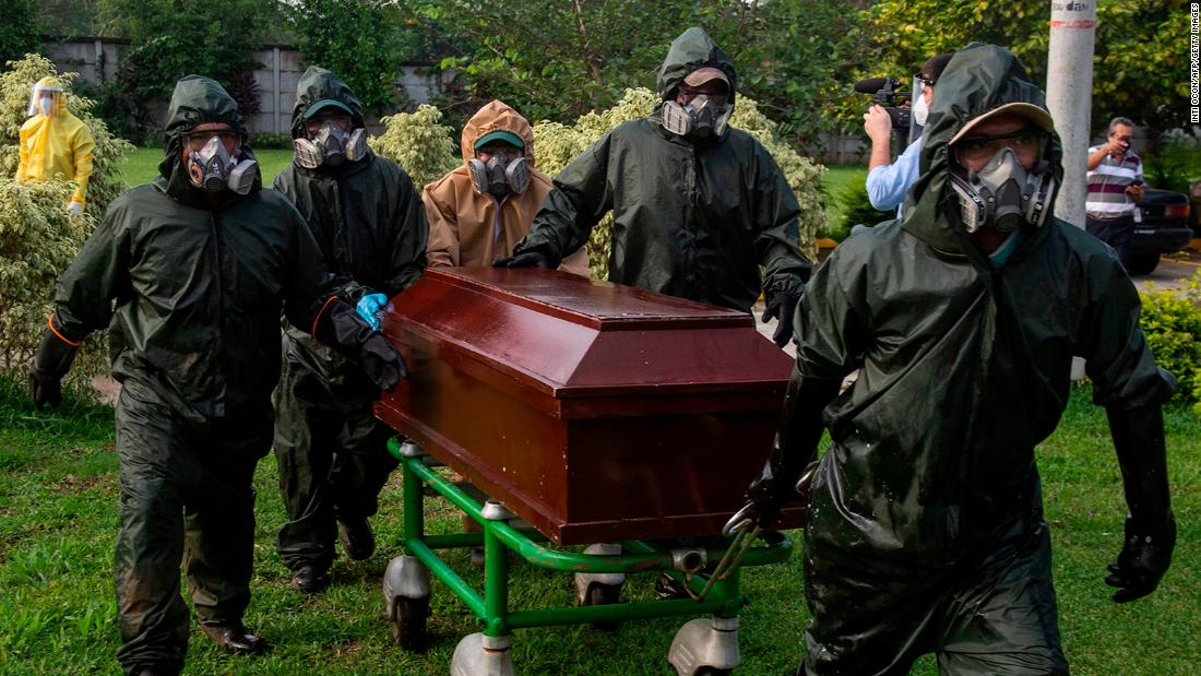 Gravediggers carry a coffin during a funeral at the Jardines del Recuerdo Cemetery in Managua on June 5, 2020, amid the new coronavirus pandemic. (Photo by INTI OCON / AFP) (Photo by INTI OCON/AFP via Getty Images)