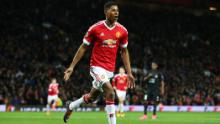 Rashford celebrates scoring on his United debut, against FC Midtjylland in the Europa League at Old Trafford on February 25, 2016.